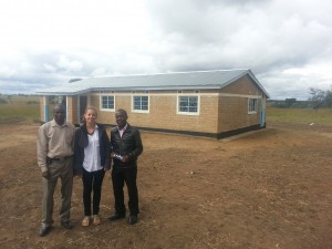 The AR Zambia team in front of the new teacher housing.