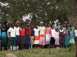 Pupils sing the Zambian National Anthem at the handover ceremony