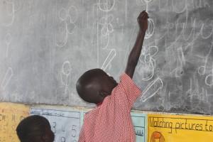 St Kizito K3 exercise on the chalkboard
