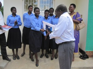 Jacinta Lakaraber, the head girl is hapily receiving the keys to the AR newly completed Dormitory from the Principal.