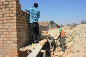 building walls to boys' latrines