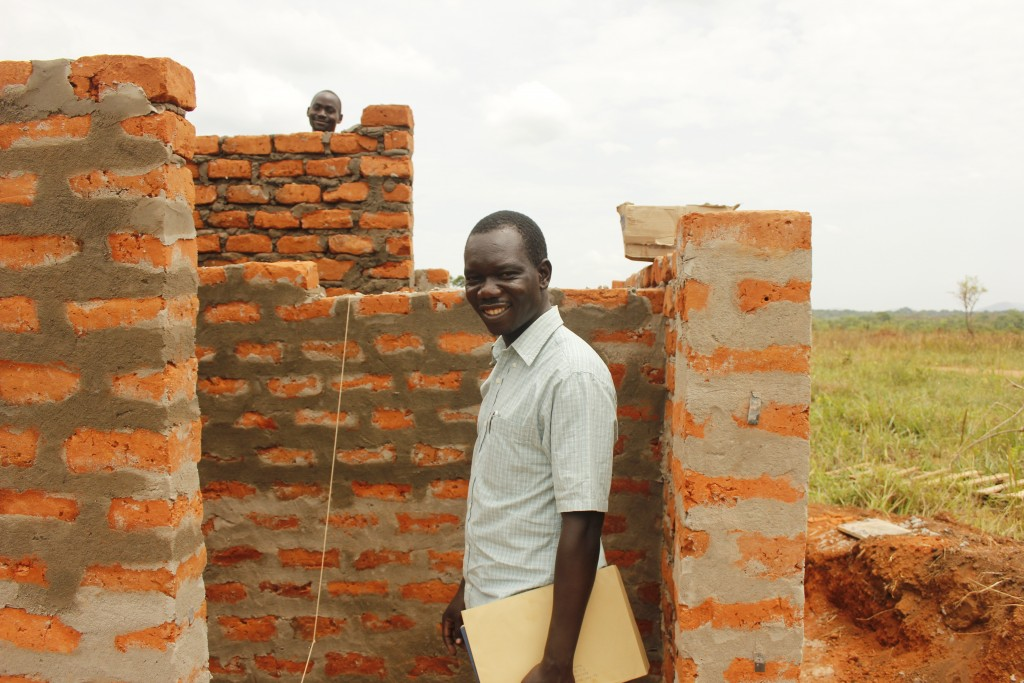 Checking on the progress of a latrine block