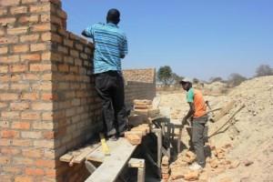 building walls to boys' latrines