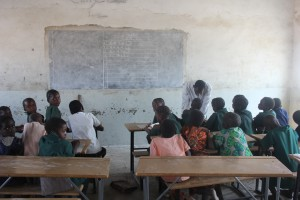 teacher working with his pupils